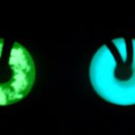 Green and Blue UVO Necklace glowing in the dark after being charged